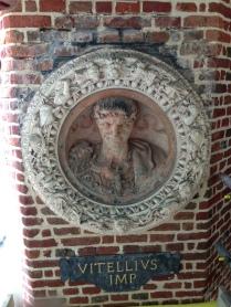 Vitellius - terracotta roundel. Frame; buff terracotta