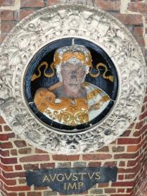 Augustus - polychromy glazed ceramic. Frame; buff terracotta