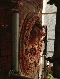 Otho - Da Maiano terracotta roundel. Frame; red terracotta